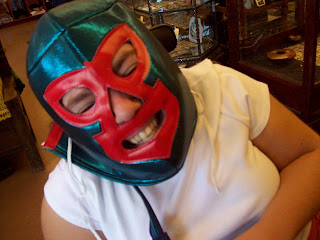 Sarah grinning in her luchadora mask