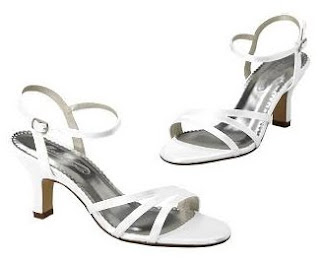 Simple white strappy shoe with a reasonable heel.