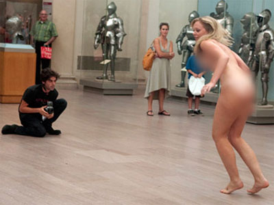 ... photographer Zach Hyman, whose shtick is nude shoots in public places.