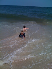 Cousins having fun in ocean