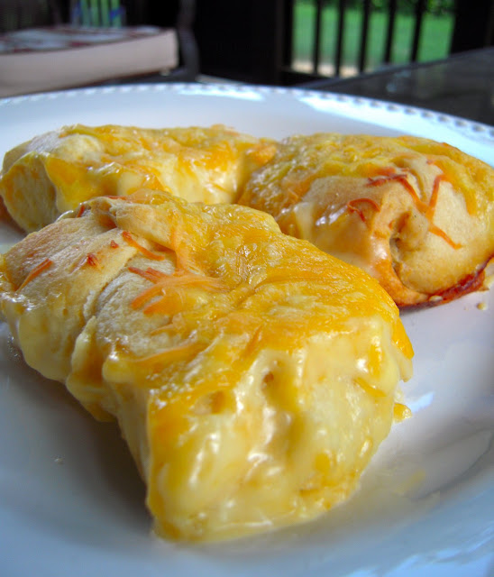 Chicken Rollups #2 - chicken and cream cheese wrapped in crescent rolls and topped cheese - These are on the menu at least once a month! Heaven in a pan! Everyone gobbles these up - we never have any leftovers.