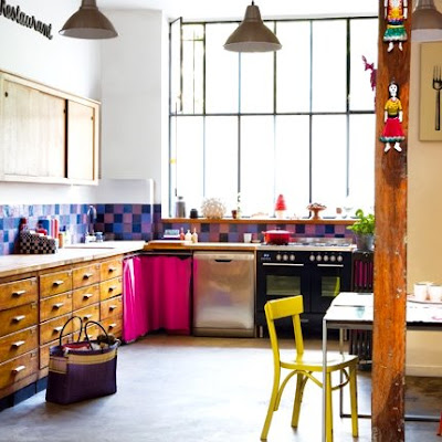 the unexpected bright colors in this kitchen