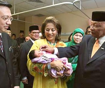 Royal touch: Sultan Ahmad Shah (right) pampering day-old baby girl named Kalsom carried by Sultanah Kalsom while Liow looks on at the hosital in Cameron Highlands recently.