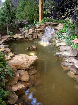 This water garden began as a derelict pond when the house for Prefab waterfalls for ponds