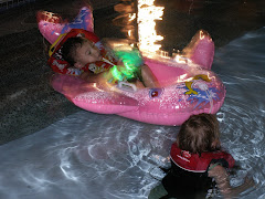 Cora was pulling Miles around in Aunt Jillzy's parent's pool! It was a lot of fun!