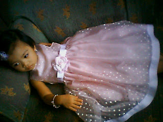 missy in her polka dot pink toddler dress