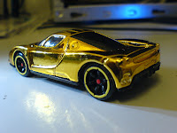 and while buying that car i spotted this just lying down at a giant hypermarket a 1535 tv batmobile hotwheel i dun really like the car but i have - Ferrari Enzo Gold