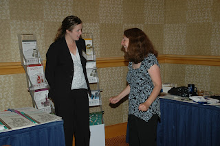 An awardee chats with Division staff.