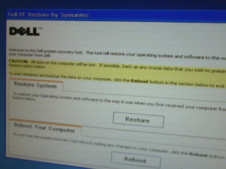 that Dell PC restore will take the system back to factory settings