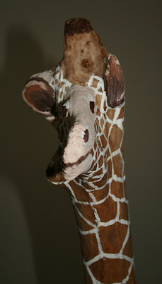 Funny painted giraffe driftwood