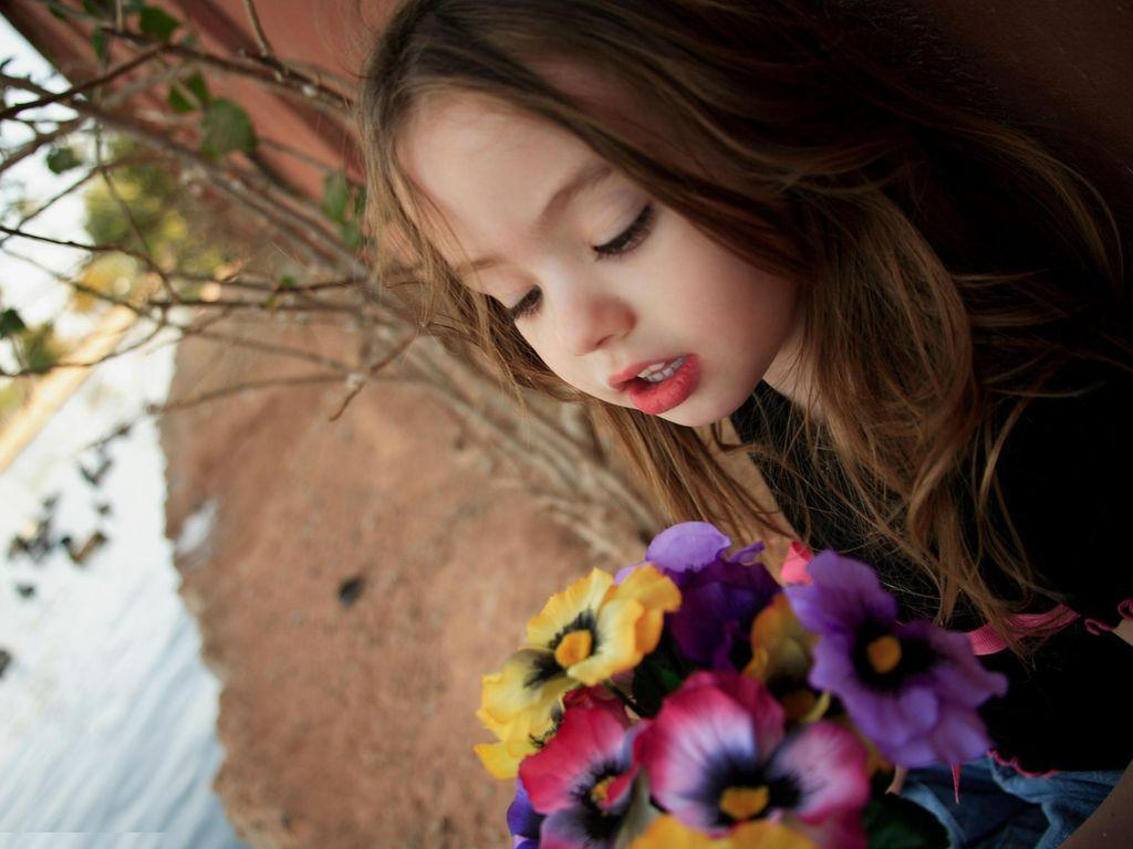 Cute babies girls with flowers hq wallpapers