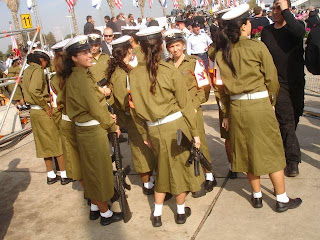 Soldiers in skirts, with M-16 Assault rifles