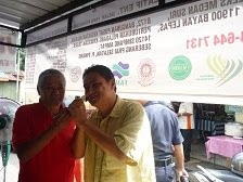 Pak Ali bersama en Aziz Desa