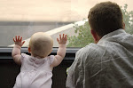 My hubby and baby K looking out the window