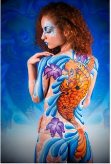 body paint koi fish in the paste on the sensitive part of woman's body