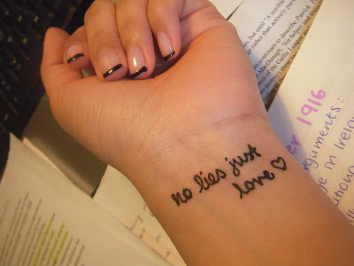 and this is the tattoo that she got cept in super ugly handwritten font