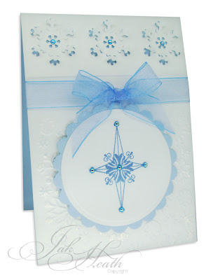 The base of the white overlay card was embossed with the A2 snowflake