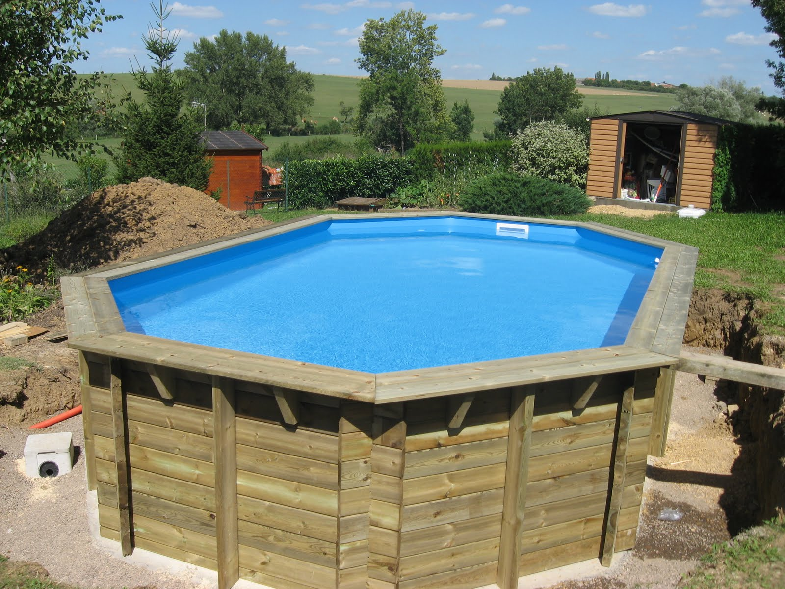 piscine semi enterr e. Black Bedroom Furniture Sets. Home Design Ideas