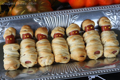 this is a childhood favorite and always the most popular of our halloween spreads cut crescent roll dough into thin strips and wrap around hot dogs - Halloween At Work Ideas