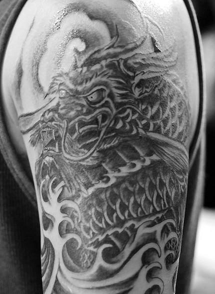 g dragon tattoo arm