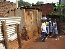 3 stance toilet shared among boys, girls and teacher before project intervention