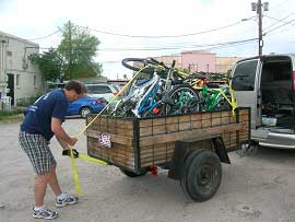 Gary LeBlanc, Superintendent of AmeriSchools, loads donated bikes for transport to Phoenix