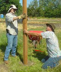 Rann and Chris building the fence