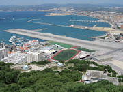 . a plane lands or departs. This is one amazing airport, just check out . (gibraltar airport)
