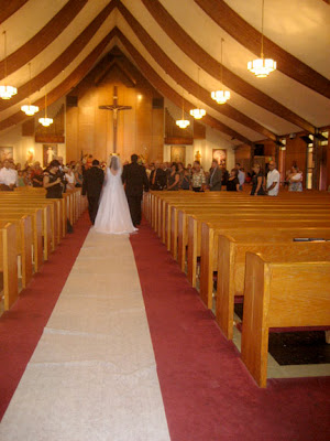 Here Lea carries her veil and train into the church
