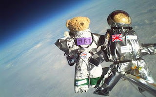 Two teddy bears have been sent on a space mission, propelled 100,000ft into the stratosphere on a weather balloon.