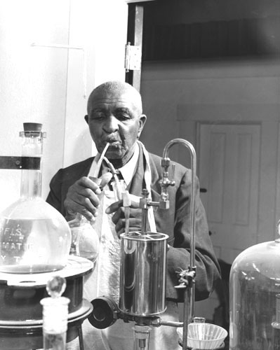 George Carver working in his lab inventing new things. title=