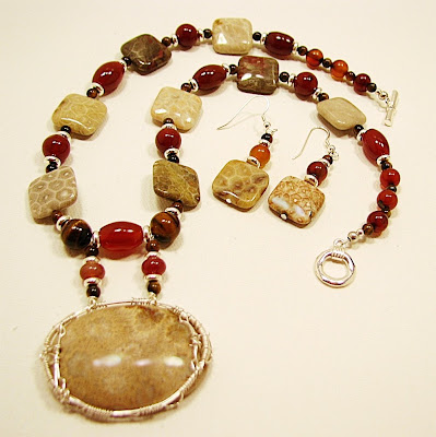 fossilized coral with carnelian tiger eye onyx and silver wire wrap by laurastaley.etsy.com