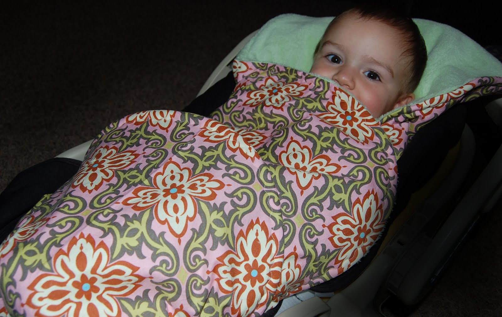 Not a car seat cover. This blanket that has 3 openings to allow your 5 ...