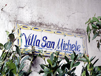 A sign on painted tiles