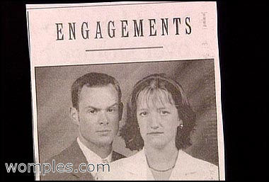 reall funny photo of engaged couple who look very unhappy
