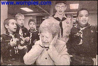 really funny newspaper photos bad singing boy scouts old woman