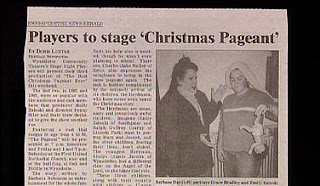 funny newspaper photo about christmas pageant with child holding doll jesus upside down