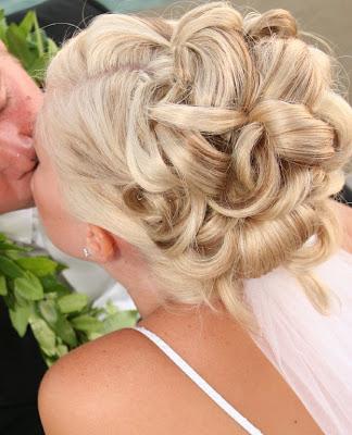 A bride will take time to consider many wedding hairstyles to make sure she