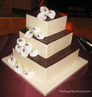 Square wedding cakes with lilies