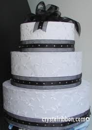 white and ribbon wedding cake