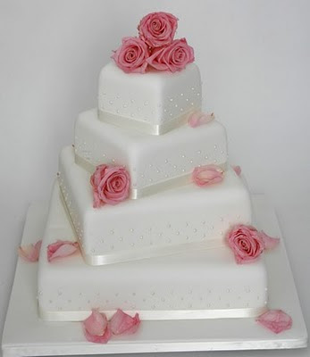 square wedding cakes flowers on top