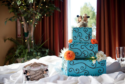 aqua wedding cake with micky mouse and flowers