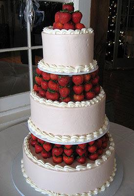 white wedding cake with fruit on top