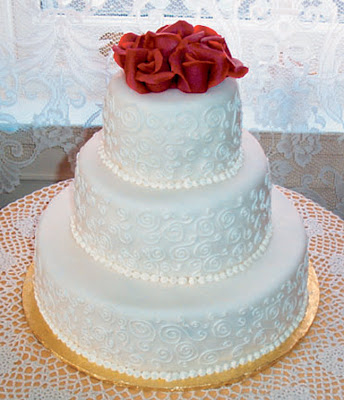 white wedding cake with rose