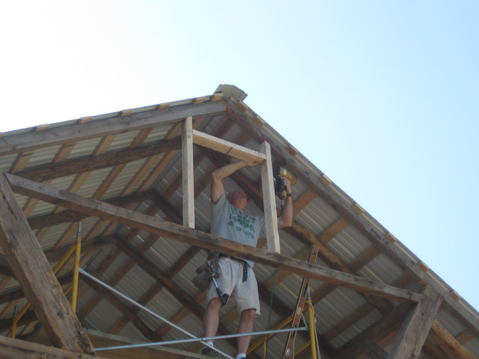This is Jeff Rhodes helping me frame out for the gable vents that I made in my workshop. I had to custom make these to fit in my opening in the gable ends. & The Beaumont Barn: Framing the Gable Vents
