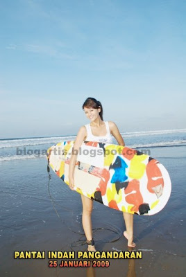 Farah Quinn surfing on the beach