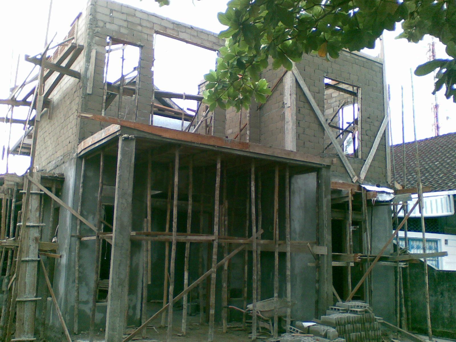 arsitek qhue renovasi fasade depan rumah dua lantai