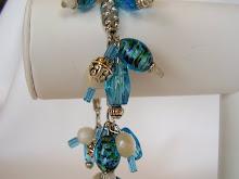 """Linda"" charm bracelets"