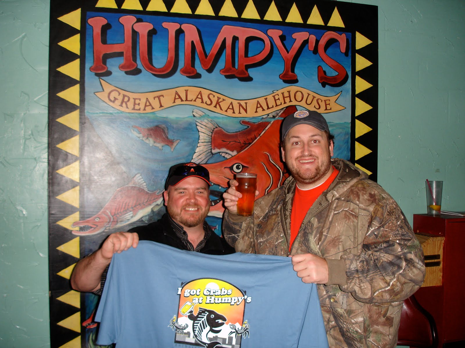 Jay poses with Shawn for a victory beer and tshirt after completing the kodiak arrest challenge at humpys great alaskan ale house
