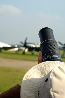Photagrapher Taking Picture of Aircraft